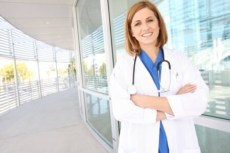 female doctor: A pretty young woman nurse outside hospital building