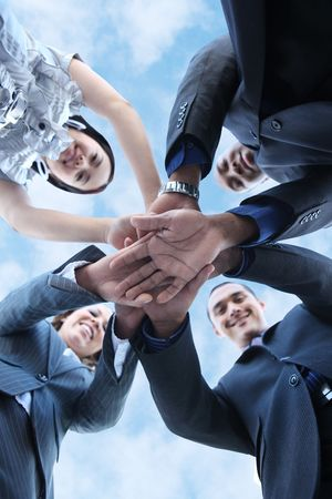 join the team: A diverse business man and woman team with hands together Stock Photo
