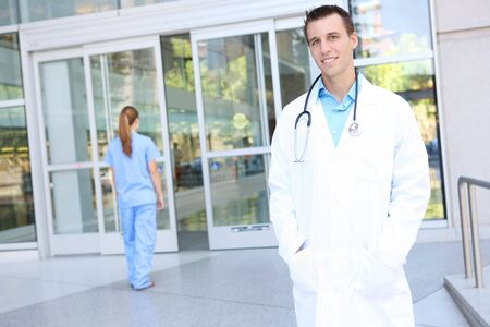 healthcare office: An attractive man doctor outside hospital building