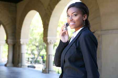A pretty african american woman at college on phone Stock Photo - 3683258
