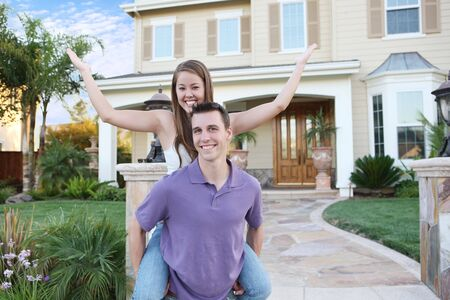 home purchase: A young couple in love in front of their new home Stock Photo