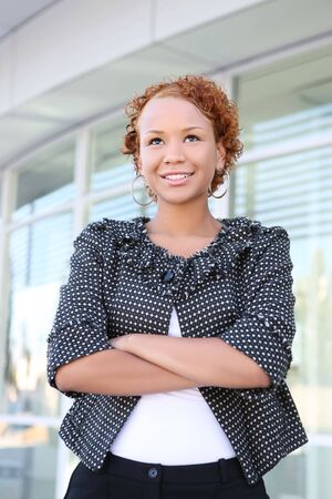 A pretty african american business woman outside office building Stock Photo - 3715038