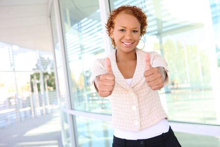 A pretty african american business woman outside office building Stock Photo - 3715034