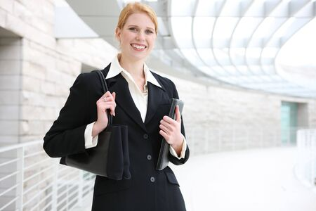 A pretty, young business woman at the office building