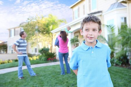 A happy family having fun outdoors in front of their home Stock Photo - 3756615