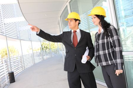 Man and woman architects on building construction site working Stock Photo - 3767985