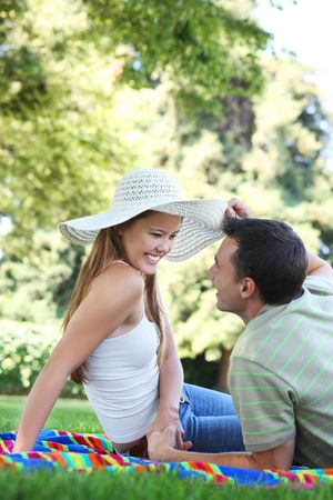 Attractive man and woman couple in love in the park photo