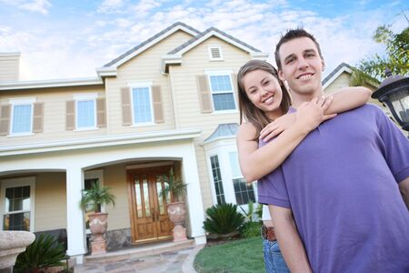 A young couple in love in front of their new home  Stock Photo