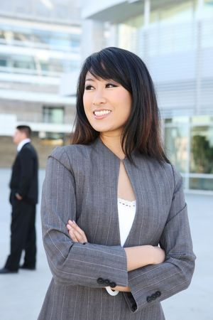 Young, beautiful asian business woman at office building