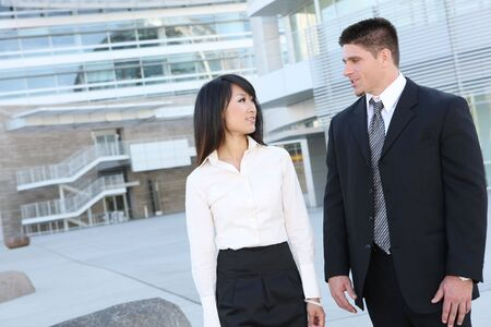 An attractive man and woman business team at their company