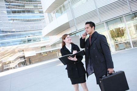 A man and woman business team at their company building Stock Photo - 3896049