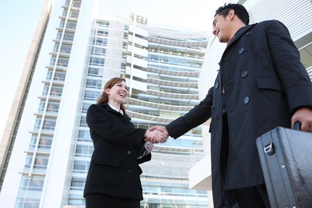 Attractive man and woman business team shaking hands Stock Photo - 3904054
