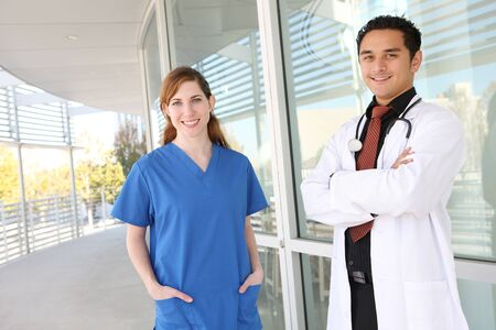 latinos: A young, attractive man and woman medical team at hospital