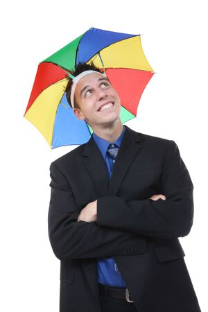 A handsome business man under a rainbow hat umbrella photo
