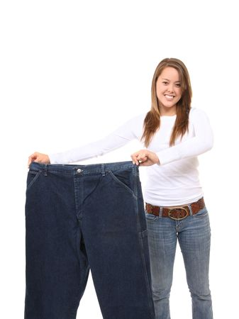 Pretty Woman on Diet Showing Weight Loss Stock Photo