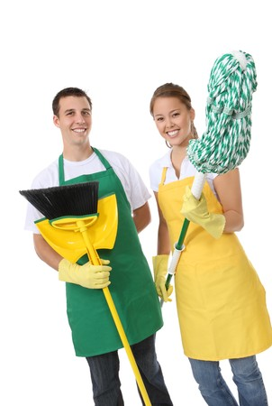 cleaning supplies: An attractive man and woman holding cleaning supplies