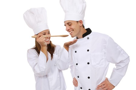 Attractive man and woman chef tasting food Stock Photo - 3987065