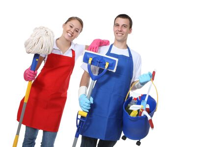 housekeeping: An attractive man and woman holding cleaning supplies