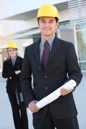 architect: An attractive business team working construction on the building site