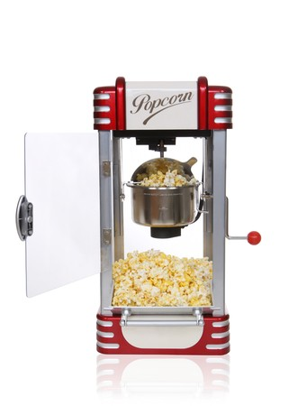 machine: A vintage retro popcorn machine over white background