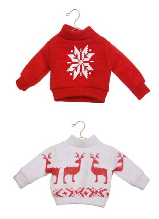 knitted: Two cute Christmas sweaters isolated over white