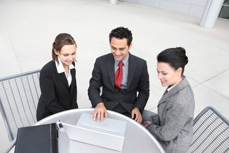 A young and diverse man and woman business team at office photo