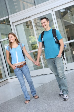 Happy attractive teenage couple at school library photo