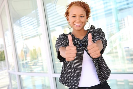 A sexy african american business woman with thumbs up Stock Photo - 4021880