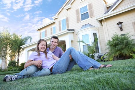 An attractive man and woman couple at front of home Stock Photo