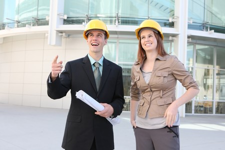 Attractive Man and woman team on a building construction site Banco de Imagens