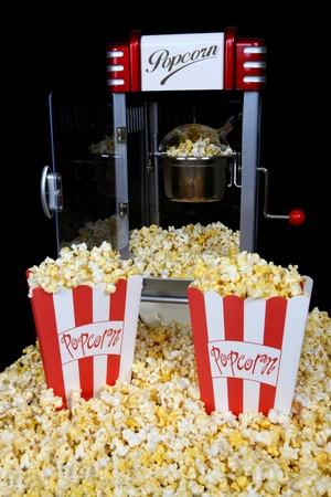 machines: A vintage retro popcorn machine over black background Stock Photo