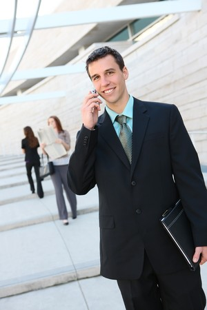 A hansome business man on the phone at office building photo