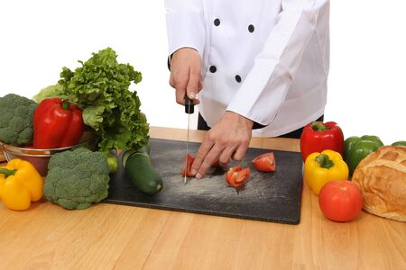 A chef cutting vegetables to prepare a food meal Stock Photo - 4052949