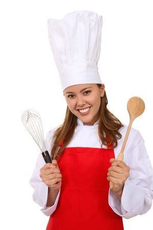 A pretty young woman chef holding kitchen utensils