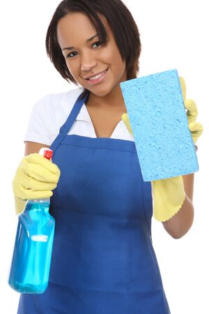 A pretty woman maid washing with spray and sponge
