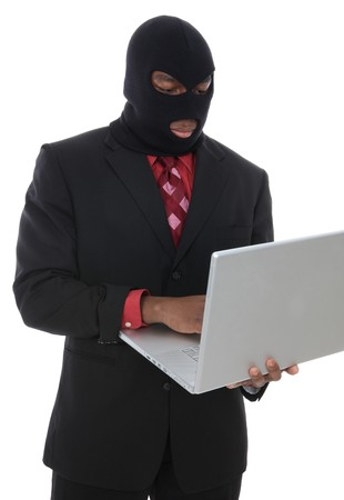 A conceptual business man computer crime theme