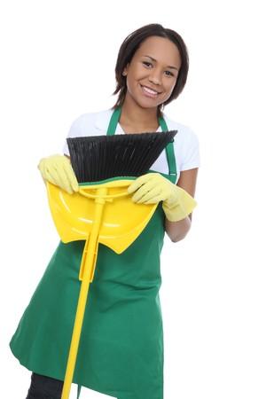 empleadas domesticas: Una hermosa mujer de limpieza limpia explotación escoba
