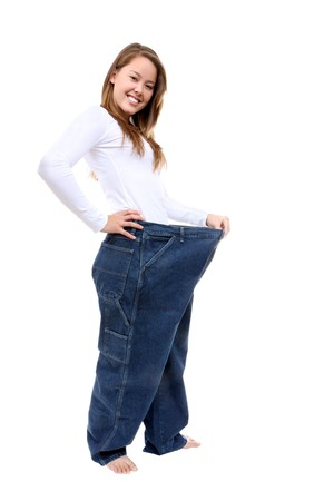 A pretty woman showing how much weight she lost photo
