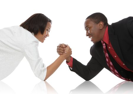 Attractive african american business man and woman arm wrestling  photo
