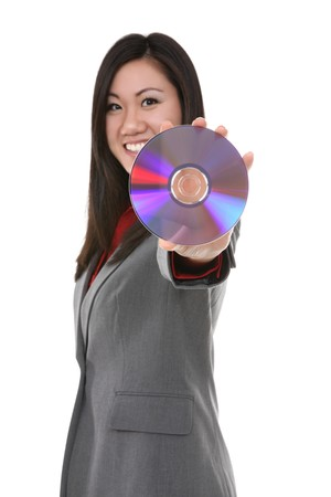 A pretty asian business woman holding dvd cd disc