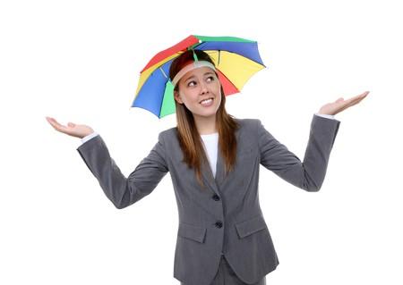 A pretty business woman under a rainbow hat umbrella