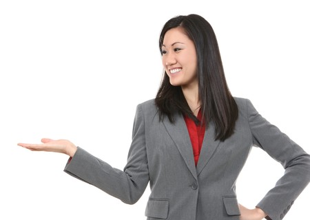 A pretty asian business woman gesturing isolated Фото со стока