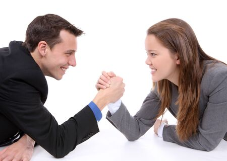 Attractive business man and woman arm wrestling  photo