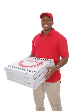 A handsome young pizza delivery man holding a pizza