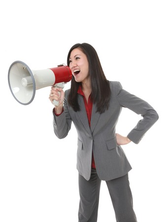 Pretty business woman yelling through megaphone photo