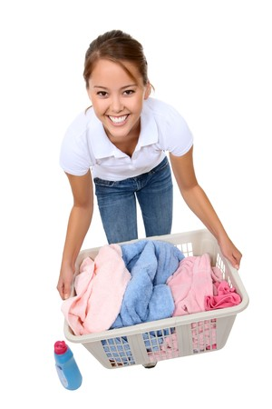 laundry basket: A pretty young woman doing laundry at home