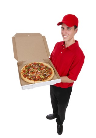 A handsome young pizza delivery man holding a pizza photo