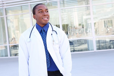 hmo: Handsome african american man doctor at hospital Stock Photo