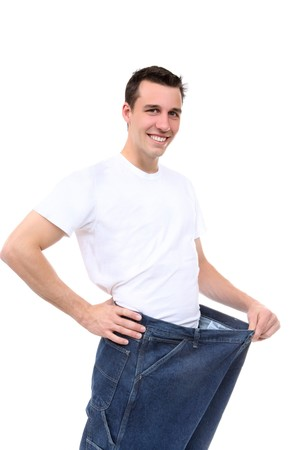 white pants: A handsome man showing how much weight he lost