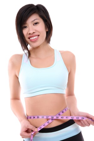 Pretty asian woman measuring waist after exercising Stock Photo - 4173885